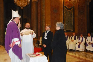 Archbishop Tobin invests Dames Donna and Riekie with the regalia of their orders